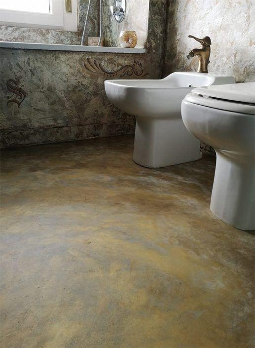 microcemento in bagno decorato oro ebronzo